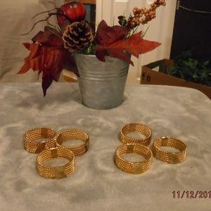 Other - Set of 6 golden napkin rings.